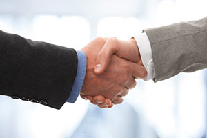 Close Shot of Two Men in Suits Shaking Hands