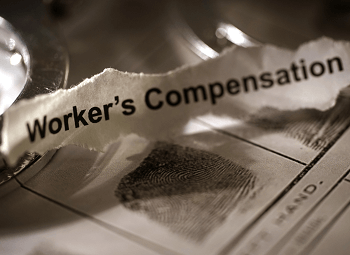 Torn piece of paper with worker's compensation typed on it